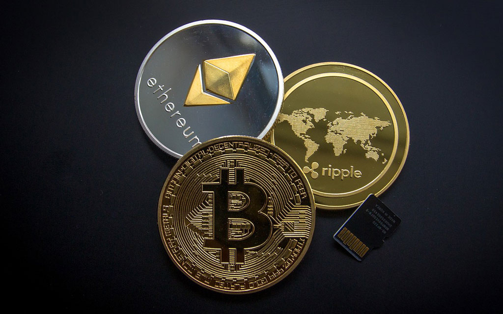 Bitcoin-Ethereum-Ripple-Muenze