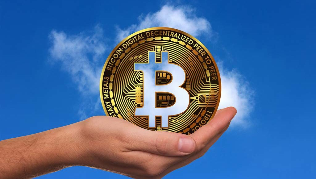 Bitcoin-Muenze-in-der-Hand